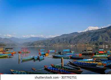 Phewa Tal (Phewa Lake), Pokhara, Nepal. A beautiful lake, backed by the Annapurna mountain range, and a big tourist draw. Pokhara is a popular starting point for treks in the Himalayas.