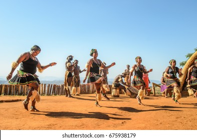 Phezulu village, Botha's Hill, South Africa - August 19, 2013: Zulu dressed in traditional gear jumping and dancing, playing drums. Ritual demonstration