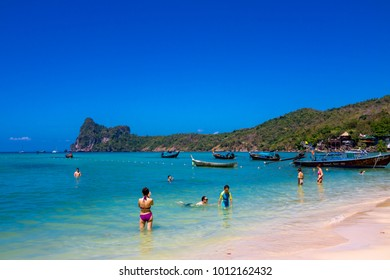 Phi Phi Island Krabi Thailand January 28, 2016 Tourists enjoying the sun at Loh Dalum beach, on Koh Phi Phi Don
