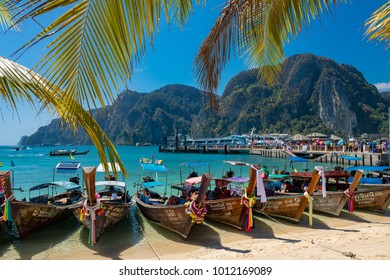 Phi Phi Island Krabi Thailand January 29, 2016 Traditional longtail boats on Loh Dalum beach, part of Koh Phi Phi Don.