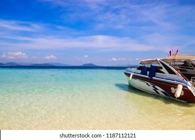 phi phi island, phuket/thailand - 5/1/2010: speed motor yacht and indigo-blue water viewed on the beach of koh khai nok island