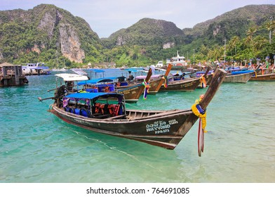 PHI PHI ISLAND, THAILAND - AUG 18,2016: Longtail boats at the beautiful beach near pier, Phi-Phi Don.