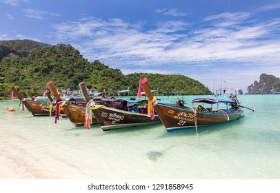 Phi Phi Island. Thailand-February 19, 2018: Traditional wooden boats on a beautiful tropical beach.