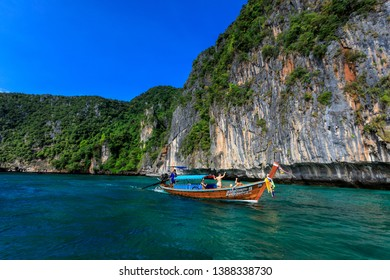 phi phi is land Thailand December 6,2018 long tail boat take foreign tourists to see phi phi island kra bi Thailand