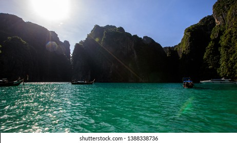 phi phi is land Thailand December 6,2018 long tail boat take foreign tourists to see phi phi island and snorkelling kra bi Thailand
