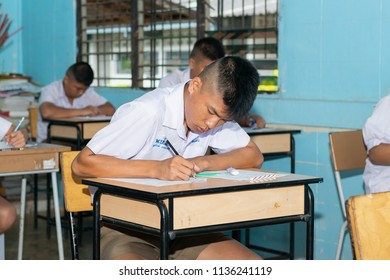 So Phi Sai, Bueng Kan/Thailand -July 17 2018: Thai Students on midterm exam at Phonthongprachasan school on the July 17 2018 in Bueng Kan, Thailand