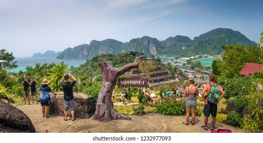 Phi Phi, Thailand - April 4, 2018 : Tourists enjoy panoramic view over the Tonsai Village and the mountains of Koh Phi Phi Island in Thailand.
