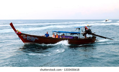 PHI PHI, THAILAND - JANUARY 07, 2018: Traditional longtail boat with tourists moving to Phi Phi island, Krabi Province, Andaman Sea.