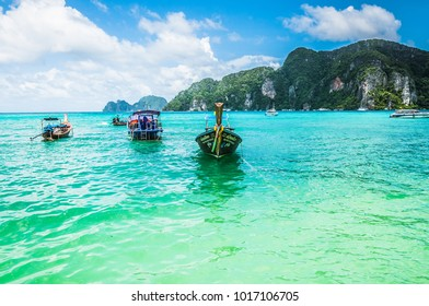 Phi Phi, Thailand - Jul 4, 2015 - Wooden boats near the border of the island in the crystal clean water