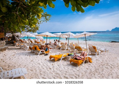 PHI PHI , THAILNAD-JAN 26, 2016: Umbrellas and sunchairs at Ao Loh Dalum beach at Phi Phi Don Island on Jan 26, 2016, Krabi Province Thailand.
