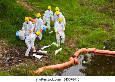 PHICHIT THAILAND-AUGUST 7:Scientific staff wear uniforms to prevent toxic chemical waste are stored in a canal countryside.On August 7, 2015 in Phichit, Thailand.