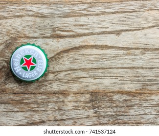 PHICHIT,Thailand - september ,2017 : heineken beer lid on wood background at Bangkok,Thailand