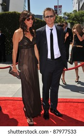 Phil Keoghan & wife at the 2010 Creative Arts Emmy Awards at the Nokia Theatre L.A. Live. August 21, 2010  Los Angeles, CA Picture: Paul Smith / Featureflash