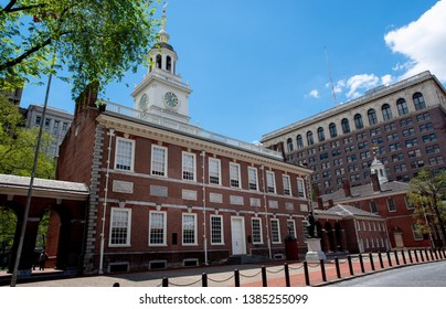 Philadelphia, PA—April 21, 2019; outside view of the red brick and wooden independence hall with clock tower in downtown; famous as the location where the declaration of independence was signed