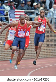 PHILADELPHIA - APRIL 28: Walter Dix from Team USA takes the baton for the anchor of a 4x100 USA vs the World heat at the Penn Relays April 28, 2012 in Philadelphia.