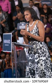 PHILADELPHIA - AUGUST 9: First Lady Michelle Obama urges supporters to spread the word and gain at least one new voter to help the outcome of a very close election on August 9, 2012 in Philadelphia.