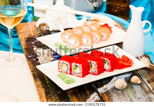 Philadelphia and California roll sushi with salmon, smoked eel, cucumber, avocado, cream cheese, red caviar. Sushi menu. Japanese food.
