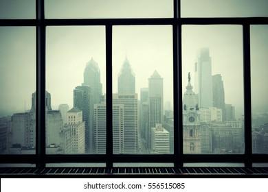 Philadelphia city rooftop view through window