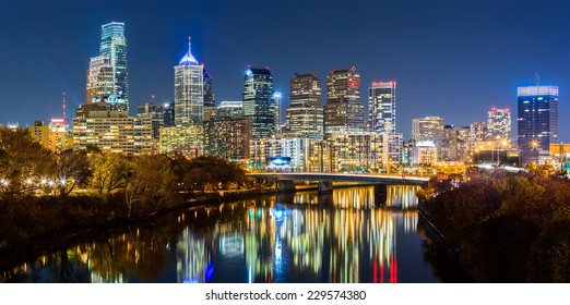 Philadelphia cityscape panorama by night. Schuylkill river reflects the colorful skyscrapers