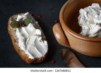 Philadelphia cream cheese on a sandwich and in a clay bowl