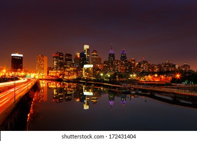 PHILADELPHIA - DEC 2: A dusk image of the City of Philadelphia reflected in the still waters of The Scullykill River, as seen from the South Bridge on Dec 2, 2013 in Philadelphia, USA.