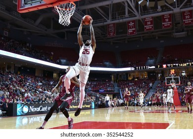 PHILADELPHIA - DECEMBER 13: Temple Owls guard Quenton DeCosey (25) elevates for a slam dunk during the Big 5 basketball game December 13, 2015 in Philadelphia.