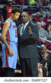 PHILADELPHIA - DECEMBER 19: Delaware State Hornets head coach Keith Walker talks to one of his players on the sideline during the basketball game December 19, 2015 in Philadelphia.
