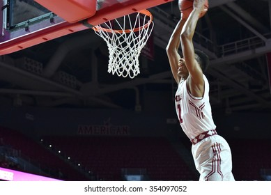 PHILADELPHIA - DECEMBER 19: Temple Owls guard Trey Lowe (11) flies in for a slam dunk during the basketball game December 19, 2015 in Philadelphia.