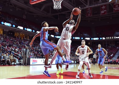 PHILADELPHIA - DECEMBER 28: Temple Owls forward Mark Williams (10) shoots after a fake during the NCAA basketball game December 28, 2014 in Philadelphia.