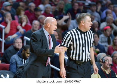 PHILADELPHIA - FEBRUARY 10:  Cincinnati Bearcats head coach Larry Davis yells at an official during the AAC conference college basketball game February 10, 2015 in Philadelphia.