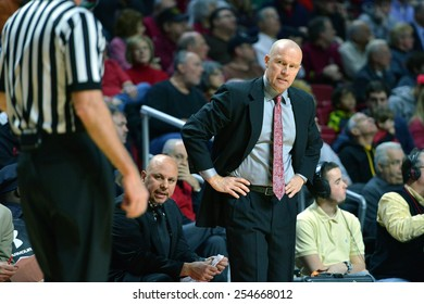 PHILADELPHIA - FEBRUARY 10:  Cincinnati Bearcats head coach Larry Davis (suit) stares down an official during the AAC conference college basketball game February 10, 2015 in Philadelphia.