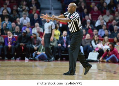 PHILADELPHIA - FEBRUARY 10:  An official makes a foul call during the AAC conference college basketball game February 10, 2015 in Philadelphia.