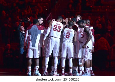 PHILADELPHIA - FEBRUARY 10:  The Temple Owls basketball team huddle as the arena is still lit in red prior to the AAC conference college basketball game February 10, 2015 in Philadelphia.