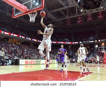 PHILADELPHIA - FEBRUARY 14: Temple Owls guard Will Cummings (2) lifts off for a lay-up during the AAC conference college basketball game January 14, 2015 in Philadelphia.
