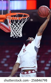 PHILADELPHIA - FEBRUARY 26:  Temple Owls guard Devin Coleman (34) goes up for a slam dunk prior to the AAC conference college basketball game  February 26, 2015 in Philadelphia.