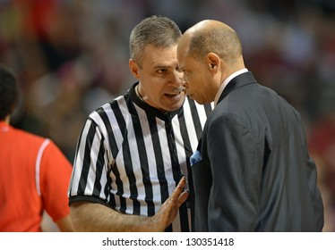 PHILADELPHIA - FEBRUARY 28: An official explains a call to Detroit Titans head coach Ray McCallum during the basketball game February 28, 2013 in Philadelphia.