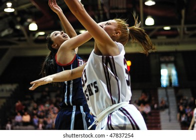 PHILADELPHIA - FEBRUARY 28: St. Joe's senior Ashley Logue (#33) goes up for a shot defended by Duquesne's Alex Gensler in the February 28, 2010 game in Philadelphia.
