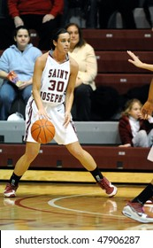 PHILADELPHIA - FEBRUARY 28: St. Joseph's University women's basketball player Amy Gillespie dribbles the ball while looking to make a pass in the February 28, 2010 game in Philadelphia