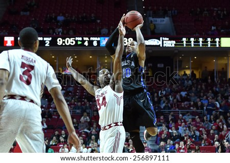 PHILADELPHIA - January 10: Tulsa guard James Woodard (10) shoots as a Temple defender tries for the block during the AAC conference college basketball game January 10, 2015 in Philadelphia.