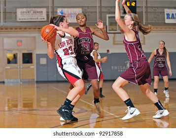 PHILADELPHIA - JANUARY 14: Olivia Cavallo (#23) of Boyertown HS protects the ball as defenders trap her during a game in the Rally Girls Play by Play Classic January 14, 2012 in Philadelphia.