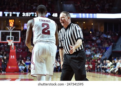 PHILADELPHIA - JANUARY 14: A referee discusses a call with Temple Owls guard Will Cummings (2) during the AAC conference college basketball game January 14, 2015 in Philadelphia.