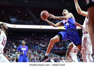 PHILADELPHIA - JANUARY 14: Southern Methodist Mustangs guard Keith Frazier (4) goes up for a shot during the AAC conference college basketball game January 14, 2015 in Philadelphia.