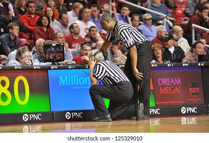 PHILADELPHIA - JANUARY 19: Two basketball officials watch a TV for an instant replay review during the Atlantic 10 basketball conference game January 19, 2013 in Philadelphia.