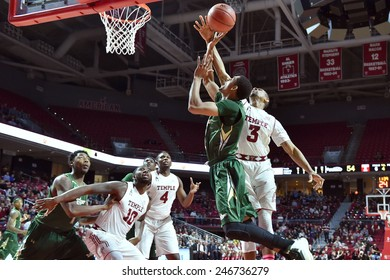 PHILADELPHIA - JANUARY 22: Temple Owls guard Jesse Morgan (3) blocks a shot by a USF player during the AAC conference college basketball game January 22, 2015 in Philadelphia.