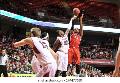 PHILADELPHIA - JANUARY 28: Rutgers Scarlet Knights forward J.J. Moore (44) shoots over Temple Owls guard Quenton DeCosey (25) during an AAC basketball game January 28, 2014 in Philadelphia.