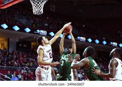 PHILADELPHIA - JANUARY 31: Temple Owls forward Obi Enechionyia (0) blocks a shot during the AAC conference college basketball game January 31, 2015 in Philadelphia.