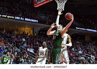PHILADELPHIA - JANUARY 31: Tulane Green Wave center Dylan Osetkowski (21) shoots over a Temple defender during the AAC conference college basketball game January 31, 2015 in Philadelphia.