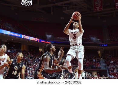 PHILADELPHIA - JANUARY 4: Temple Owls guard Jesse Morgan (3) drives down the lane and takes a shot during the American Athletic Conference basketball game January 4, 2015 in Philadelphia.