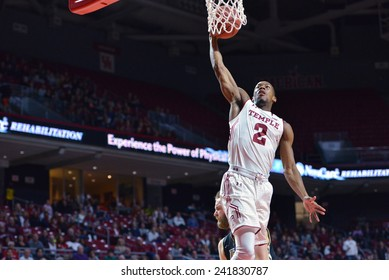 PHILADELPHIA - JANUARY 4: Temple Owls guard Will Cummings (2) lifts off for a dunk during the American Athletic Conference basketball game January 4, 2015 in Philadelphia.
