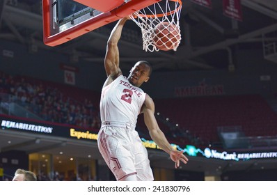 PHILADELPHIA - JANUARY 4: Temple Owls guard Will Cummings (2) finishes a slam dunk in the American Athletic Conference basketball game January 4, 2015 in Philadelphia.